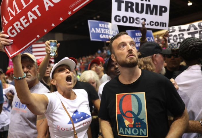 The QAnon conspiracy has evolved to endorse Trump's big election lie (Joe Raedle/Getty Images)